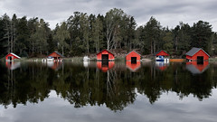 Morning, after rain (Jaanus Remm) Tags: åland water sea reflections red forest trees boat shed finland summer morning finstrom reflection