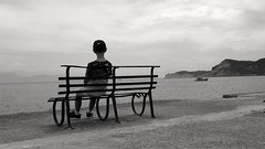 Daydreaming..... (markwilkins64) Tags: markwilkins greece corfu sidari blackandwhite bw mono monochrome sea bench ironbench clouds albania peace tranquility tranquil solitude dreaming daydreaming seascape headland