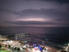 Beachfront Thunderstorm (amyg903) Tags: beach city lightning storm ocean beachfront night shore waves sand pier light