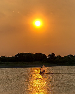 Sailing to a back in the setting sun