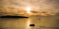 Summer Evenings (Mark Palombella Hart) Tags: cymru landscape rest row sailing sea relax reflection outdoor peace seascape travel vacation water tranquil surreal sunlight sunset cloud discovery calm alone boat freedom mindful nature inspiration life silhouette
