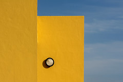 Yellow walls and lamp (Jan van der Wolf) Tags: map18163vv yellow geel lamp light geometric geometry geometrisch geometrie architecture architectuur fuerteventura sky wall muren minimalism minimalistic minimalisme minimal