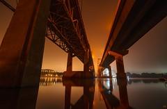 Generation Gap. (Nomadic Complacency) Tags: night nightphotography bridge bridges fog lights architecture river mist mississippiriver sony sonyalpha