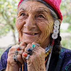The Gems of Age (ZeePack) Tags: old woman aryan ladakh dha batalik jammuandkashmir india buddhist smile wrinkles hands rings traditional jewellery culture ancient costume ethnic canon 5dmarkiv milestoneenterprise milestoneenterprisein plaits portrait