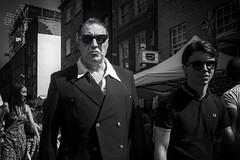Cereal killer (markfly1) Tags: cereal killer man sinister look large surly noir film black white candid image street capture 35mm nikkor lens brick lane london england people walking by sunglasses funny moment nikon d750