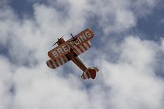 The Flying Circus Wingwalking Team, Shuttleworth Collection Family Air Show, Bedfordshire (IFM Photographic) Tags: img3995a breitlingstearman breitling stearman theflyingcircuswingwalker wingwalker wingwalking nikita aerosuperbatics canon 600d sigma70200mmf28exdgoshsm sigma70200mm sigma 70200mm f28 ex dg os hsm apo tele converter 2x af teleconverter oldwarden bedfordshire beds shuttleworthcollection shuttleworthhouse familyairshow airshow aircraft aeroplane plane airplane boeing