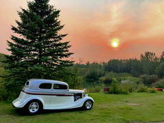 The visitor: A 1933 Ford Vicky and a smoky sunset (+1) (peggyhr) Tags: peggyhr sunset smoky lake bench trees canoe 1933fordvicky img4918a bluebirdestates alberta canada thegalaxy thegalaxystars thegalaxylevel2 thegalaxyhalloffame