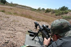 This trained police sniper is using the same equipment civilian long range shooters and hunter would take into the field. (huntingmark) Tags: guntest gun rimfire optics testing shooting field range warmup target longrange 308win wildcat hunter expert scope sniper itacha nightforce 65creedmoor creedmoor ruger chassis rifle hunting 300win blackout hornady