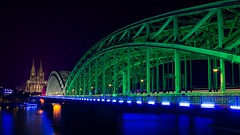 Colonia in Gamecom colors (Renate Bomm) Tags: licht renatebomm sonyilce6000 sigma16mmf14dcdn nacht rheinbrücke rhein dom kölnerdom blue cityscape citynights city longtimeexposer brücke blaue stunde cologne river flickrunitedaward pictureoftheday unesco weltkulturerbe bridge fluss wasser noche night illumination something felana colonia nrw kölner long exposer hour blau gebäude architektur heimatstadt heimat sky skyscape dusk dämmerung weather colours world beautiful capture skyline outdoor hafenviertel himmel