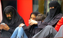 `2356 (roll the dice) Tags: london westminster westend oxfordstreet veiled muslim religion culture surreal sad mad fun funny banned streetphotography urban england unaware unknown people fashion bargain sale family pretty sexy girl bored happy smile rest portrait strangers candid canon tourism tourists hot sunny weather burka eyes niqab hijab arab dark lost talk mobile phone tex