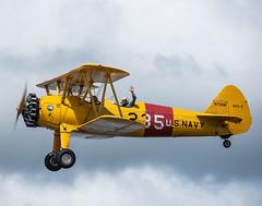 Stearman_117867 (gpferd) Tags: 2xteleconverter airplane boeingn2s clouds people stearman vehicle vintageairplane