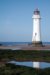 Reflections of New Brighton lighthouse (Siyah Kedi Photography) Tags: newbrighton wirrel perchrock lighthouse sky sea sand reflection beach rocks people