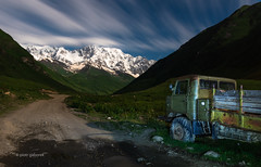 Road to Glacier (pietkagab) Tags: night longexposure truck soviet ushguli road roadside svaneti svanetia georgia georgian caucasus greater mountains mountainrange range slopes terrain stars star trails clouds pietkagab photography pentax pentaxk5ii piotrgaborek travel trip tourism trekking trek hike hiking holidays adventure landscape europe european ushba mountain mt