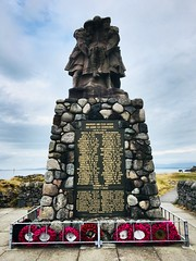 War Memorial at Oban. (Bennydorm) Tags: roadside coast clouds sky soldiers military dunollie stonework poppies wreaths iphone6s luglio julio juillet july lascozia escocia ecosse schottland scotland oban names ww2 ww1 remembered tribute rip inremembrance memorial