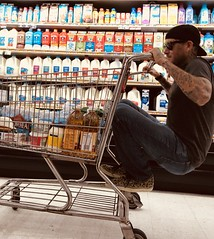 Age is just a number. (jamestapparo) Tags: life enjoy selection shop course crash juvenile horseplay number troublemaker trouble milk store shopping cartracing fun youngsoul bigkid aged grocery riding groceries age cart youth