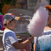 Boy with cap eating cotton candy