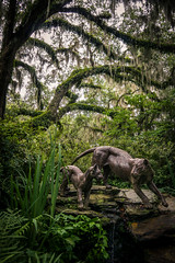 In the Jungle (dayman1776) Tags: sculpture statue escultura skulptur bronze brookgreen gardens south carolina trees cloudy lioness lion cub animal animals pair two