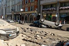 Devastation (Geoff Henson) Tags: cars crash debris wreckage wheels dust rubble broken upturned smashed london street road pavement sidewalk buildings
