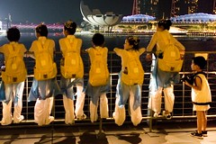 Can I take your photograph? (andrewchewcc) Tags: boy girls uniform singapore marinabay bay water night lights building bridge color