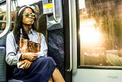 On the subway - Shiny (François Escriva) Tags: street streetphotography paris france candid olympus omd woman girl sunglasses rbf colors blue orange light yellow photo rue face underground tube