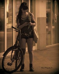 Patch (Robica Photography) Tags: robicaphotography d3200 2018 streetphotography straatfotografie tilburg woman face evening bicycle bike street glow cellphone longhair bag darkkey darktone