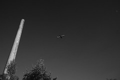 Chimney, airplane, and moon, Berlin (Germany) (Steffen Kamprath) Tags: colours people germany blackwhite minimal sonya6000 light berlin documentary outside availablelight day sky urbangeometry nopeople europe city carlzeisssonnarte1824za apsc allemagne bw deutschland emount europa mirrorless monochrome primelens sel24f18z urban urbanlandscape urbanlife zeiss