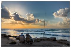 Good Hours (Raul Kraier) Tags: fisherman ocean cloud sunset ray hat smoking fishing leisure beach friends canon6dmarkii sigma35mmf14art batgalim haifa reflection horizon