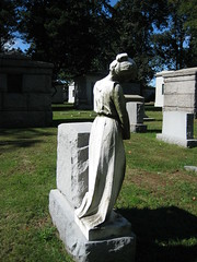 Mourner Statue sculpture grave memorial tomb 0895 (Brechtbug) Tags: mourner statue sculpture grave memorial tomb profile graveyard marble cemeteries nyc monument cemetery woodlawn horn tombstone crypt standing holding hands bronx new york city photographed 2007