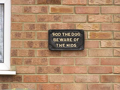 Sod the Dog. (marsh_maureen) Tags: sign bricks notice brown plaque wall