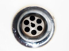 Stainless steel sink plug hole (www.icon0.com) Tags: drain cleaning water down sink steel stainless kitchen household home squander plug hole tableware resources closeup pipe dirty nobody discharge plumbing liquid loss sanitary bright head circle stream jet flush abstract flowing fragment drop shiny dishes swirl motion washing pour house cleanliness running domestic concepts metal