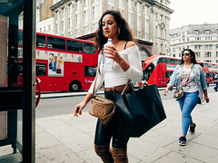 Oxford Street. 20180814T12-06-27Z_1 (fitzrovialitter) Tags: peterfoster fitzrovialitter city camden westminster streets urban street environment london fitzrovia streetphotography documentary authenticstreet reportage photojournalism editorial captureone olympusem1markii mzuiko 1240mmpro microfourthirds mft m43 μ43 μft geotagged oitrack girl candid portrait streetportrait smoke smoking cigarette