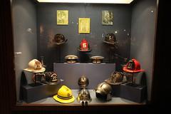 Firefighter Helmet Exhibit (rocbolt) Tags: antique vintage northcharlestonamericanlafrancefiremuseum firefighting fire firedepartment firemuseum museum charleston southcarolina charlestonsouthcarolina firefighter firetruck