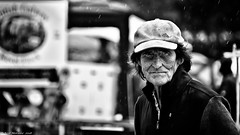 Sunshine and Showers. (Neil. Moralee) Tags: middevonshow2018neilmoralee neilmoralee man face portrait farmer rain mid devon show candid raining old mature wrinkles wrinkled hat cap black white bw bandw blackandwhite eyes stare wet summer british sunshine showers fair county country mono monochrome neil moralee nikon d7200 adidas