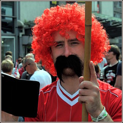 Fan (* RICHARD M (7.5 MILLION VIEWS)) Tags: street portraits portraiture streetportraits streetportraiture wig redwig falsemoustache falsemustache moustache mustache flasemustache fun footballfan footballsupporter liverpoolfootballclub lfc ynwa jft96 soccer soccerfan soccersuporter liverpudlian scousers scouse merseysiders liverpool merseyside fancydress curlywig fakemoustache fakemustache fake lol merseysider happy happiness disguise