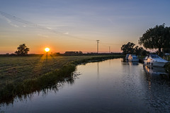 Upware sunset (Tris1972 (tmorphewimages.co.uk)) Tags: upware river rivercam cam cambridgeshire wicken ely fens sunset sun boats water reflections sky summer drone droneography dji djiphantom4advanced uav warm tranquil peaceful