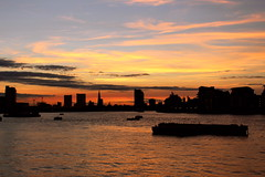 The sun setting at Greenwich Pier (Rae_Gellel) Tags: greenwich royal london england uk south east se pier thames clipper river water sunset dusk colourful city sky boat boats skyline