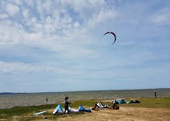 Day 2 - Kite boarding along the lagoon bordering the dune causeway that connects Cap Aux Meules Island with Havre Aubert Island. (Bobcatnorth) Tags: lesilesdelamadeleine magdalenislands quebec canada summer 2018 cycling velo bicycle bicycling cycletouring bicycletouring touring tourdevelo gulfofstlawrence