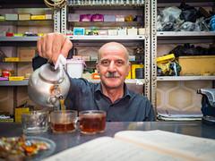 Tea time in Tabriz (TeunJanssen) Tags: tabriz iran travel portrait tea store hardware dof 17mm 17mmf18 traveling worldtravel backpacking olympus omd omdem10 shop man