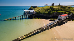Aerial drone view of old and new lifeboat houses in the picturesque Welsh seaside town of Tenby (WhitcombeRD) Tags: welsh resort sand high bay tourist destination holiday sea summer beach ocean uk coastal life boat boathouse aerialview pembrokeshire view lifeboat slipway building guard above tenby coastguard rescue harbor station aerial nautical town colorful house wales old tide vacation britain travel coastline british history colourful drone tourism coast harbour seaside