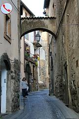 gotta call... (daniel.virella) Tags: orvieto umbria italia woman phone red street arch lamp door window balcony town city picmonkey