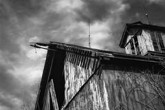 A Barn Top (Modkuse) Tags: barn oldbarn oldbuilding oldwood monochrome monochromefromslide slide slidefilm fujifilm fujichrome bw blackandwhite sky building nikon nikonn90s