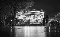 Sometimes I just want to go in circles (PeterThoeny) Tags: london unitedkingdom uk carousel merrygoround wheel fun christmas celebration people tree water puddle waterpuddle reflection motion motionblur blur park city riverthames night monochrome blackandwhite sony sonya7 a7 a7ii a7mii alpha7mii ilce7m2 fullframe fe2870mmf3556oss 1xp raw photomatix hdr qualityhdr qualityhdrphotography fav100