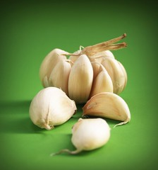 Fresh garlic (www.icon0.com) Tags: garlic meals seasoning white clove closeup isolated ripe nobody natural spice green organic bulb life leaf flavor vitamins aromatic condiment vegetable three pink object healthy still group plant spiciness ingredient part fruit fresh nutrition spicy harvest food eating parsley