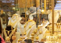 The Jewel (ybiberman) Tags: israel jerusalem oldcity alquds muslimquarter jewelrystore ethiopian eritrean baby mother interested veil mirror candidstreet photography people jewels gold backpack