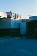 San Jose (bior) Tags: canoneoselaniie elaniie elan kodakektachrome ektachrome expiredfilm 35mmfilm sanjose kodakektachrome160t ektachrome160t parkinglot building venetianblinds sign