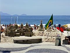 photo - Copacabana Beach, Rio (Jassy-50) Tags: photo riodejaneiro rio brazil copacabanabeach copacabana beach people sandsculpture sculpture bench sidewalk walkway promenade unescoworldheritagesite unescoworldheritage unesco worldheritagesite worldheritage whs publicart art artwork flag