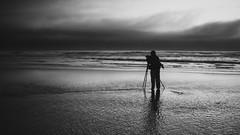 Beach Photographer (Chris Lakoduk) Tags: photographer photography blackandwhite monochrome digital nikon ocean cannonbeach silhouette water pacific oregon oregonbeaches