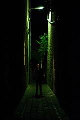 La ruelle (The_Forgotten_Legacy) Tags: france besançon ruelle rue nuit night sombre lumière light vert green homme man men alone seul ville noir dark darkness arbre tree scary peur portait model modèle pose de nightcity