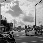 Intersection, motorcyle, clouds thumbnail