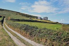 House on the Hill, Saunton ( Explored 10/08/18 ) (James Mans) Tags: explored nikon d5500 sigma sigma1750 175028 north devon saunton coast house hill hillside lane countryside road grass sky landscape